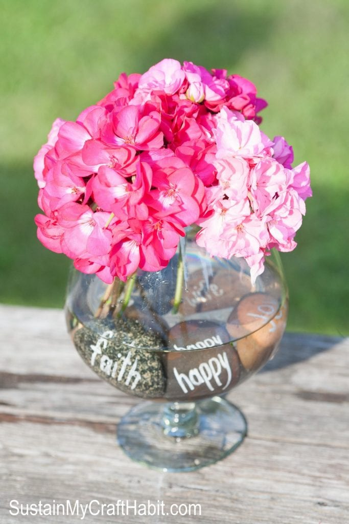 Stunning centerpieces don't have to break the bank. Try this DIY stone inscribed fresh flower centerpiece for your next special event.