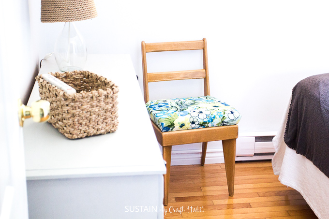 Reupholstered wood chair for a beach themed bedroom makeover.