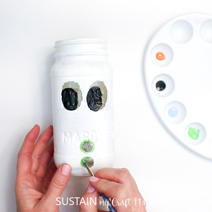 Painting green buttons onto this Mason Jar craft idea