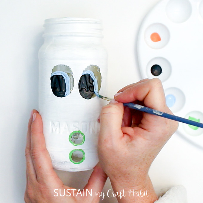 Adding pupils onto the Mason Jar snowman eyes