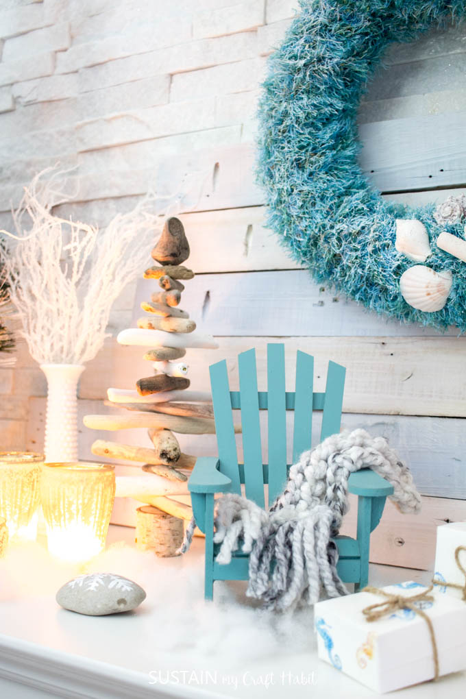 DIY cozy coastal Christmas mantel decorating ideas | Beach themed holiday mantle with teal and white accent pieces | #CoastalChristmas home tour #cbhometour
