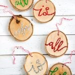 DIY wooden Christmas ornaments handlettered with glittering lyrics from Silent Night | Wood slice ornaments for Christmas | Holiday decor ideas
