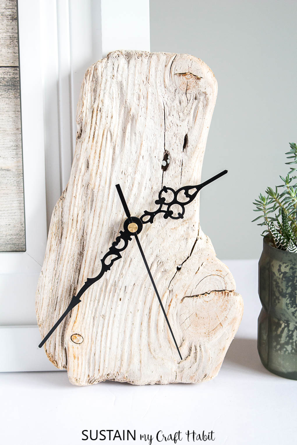 A lovely clock made with a piece of beach-found driftwood and an inexpensive clock kit.
