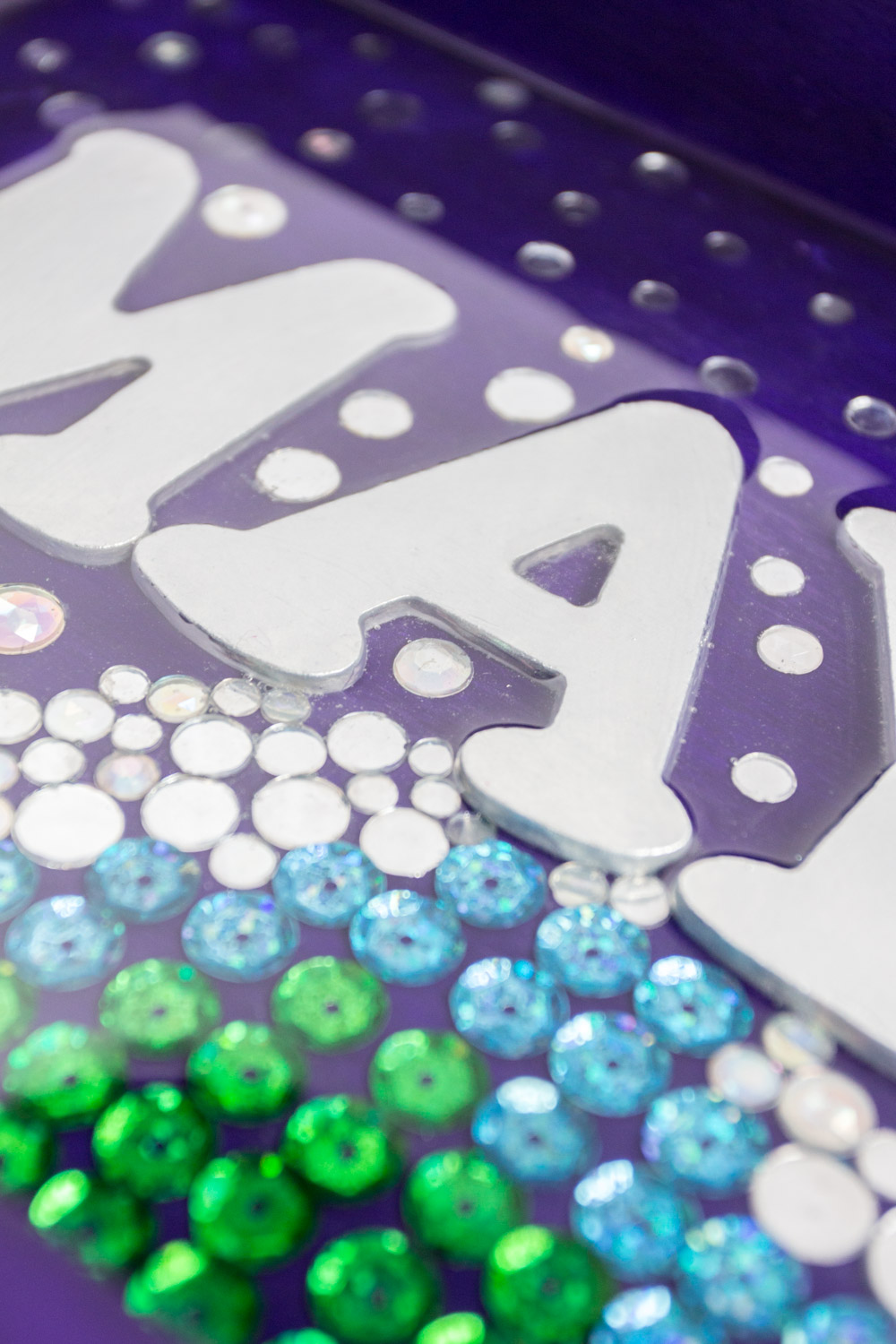 Close up image of sequins and gems embedded in EnviroTex Lite resin