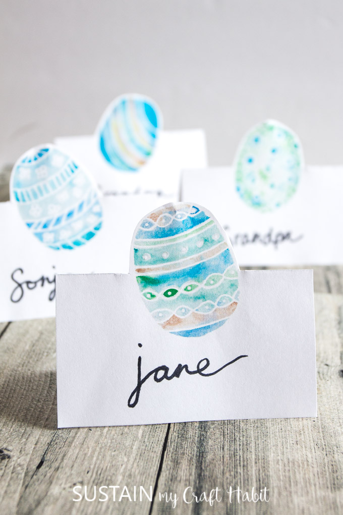 Four blue and green watercolor Easter egg place cards