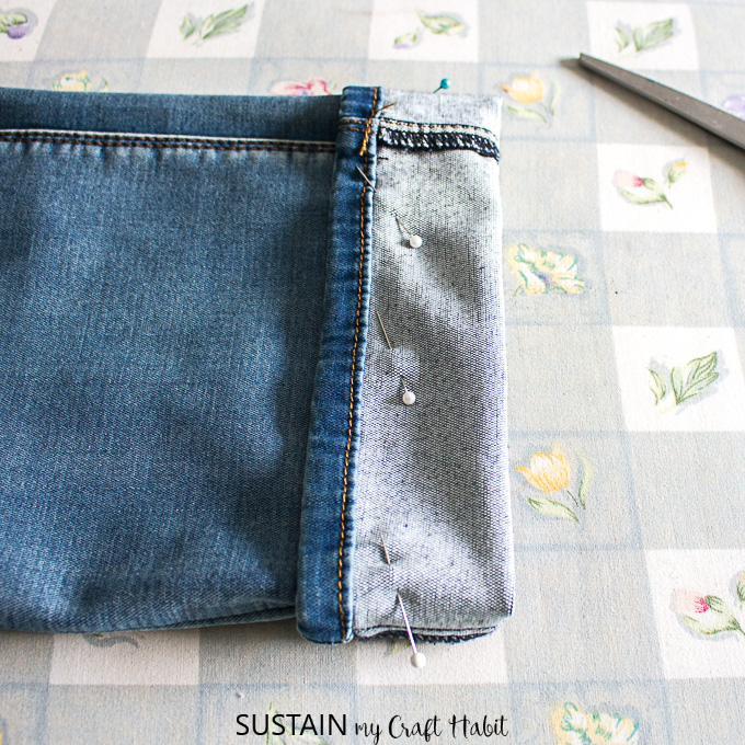 pin hem in place to shorten jeans while keeping the original hem