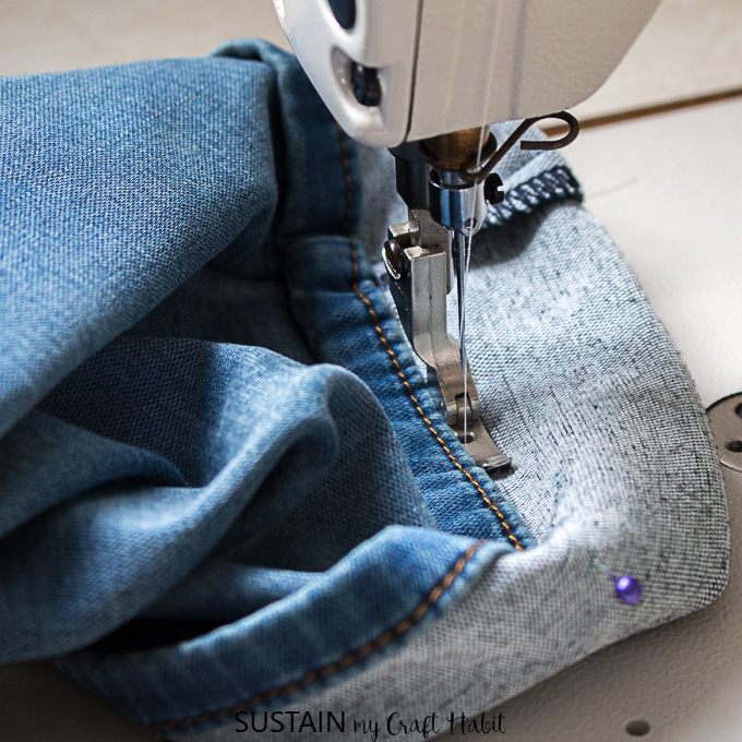 sewing the new hem with a right pressor foot