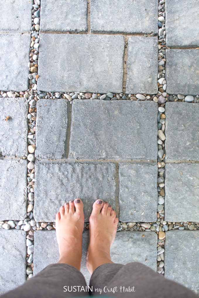 Top-down view of gray patio stones from an outdoor shower