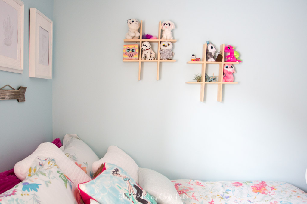 Beenie boo storage idea on small wall shelves above a bed