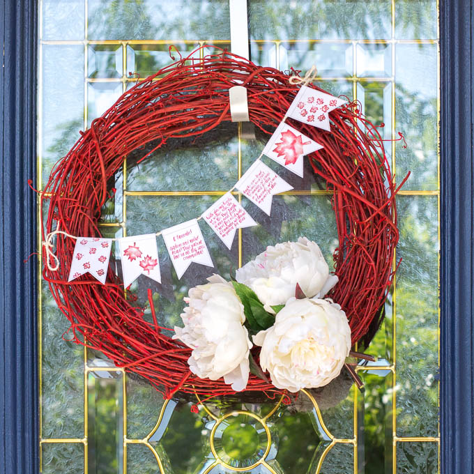 Red and white wreath on a front door to celebrate Canada Day
