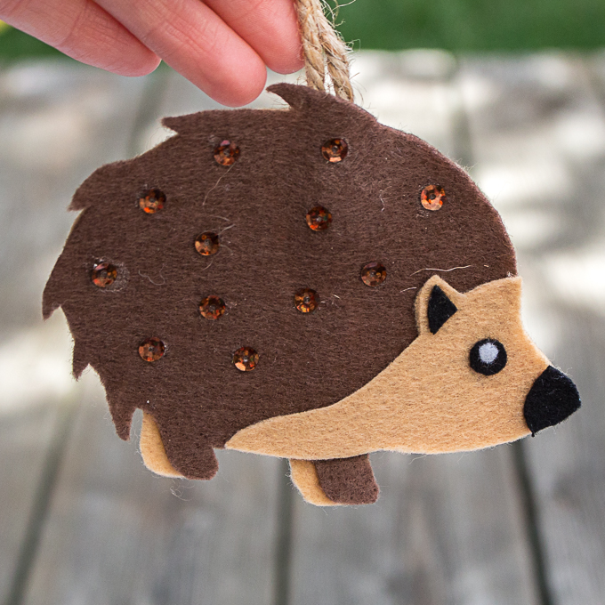 A baby porcupine felt ornament with sequins