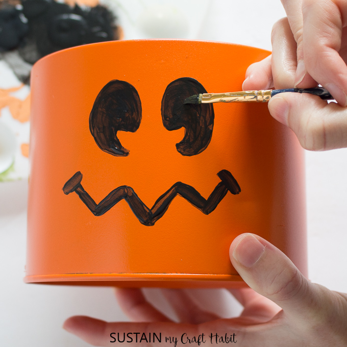 Painting eyes onto an tin can pumpkin and more halloween decorating ideas