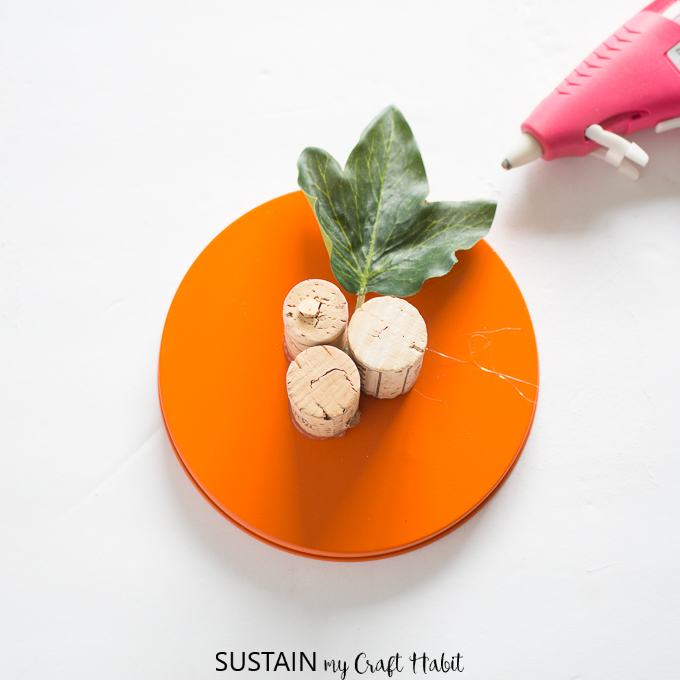 Using wine corks to make a stem for an upcycled cookie tin pumpkin