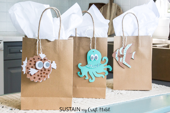Blowfish, octapus and clownfish printable gift tags on brown craft paper gift bags with white tissue paper