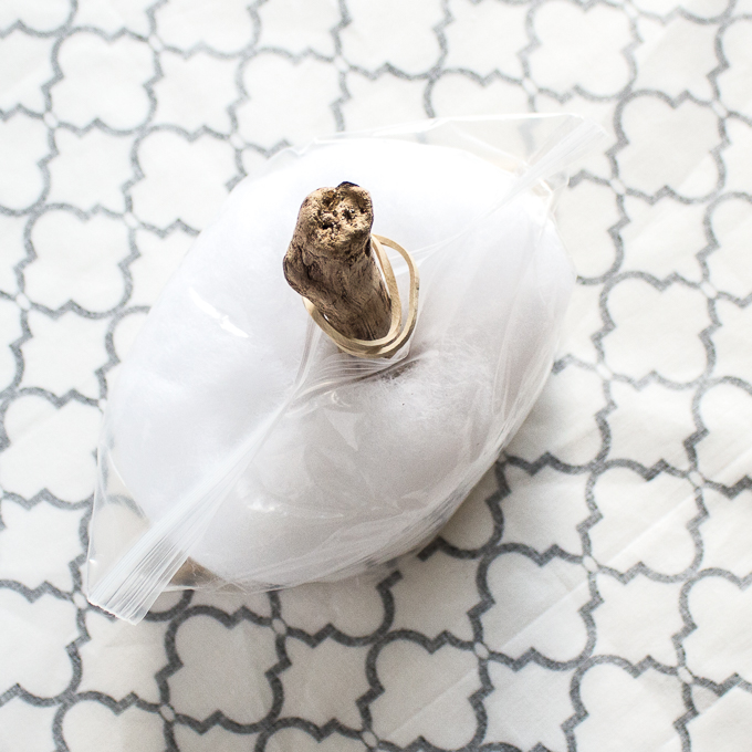 Lay the fabric circle with right side facing down and place the filled bag in the center.