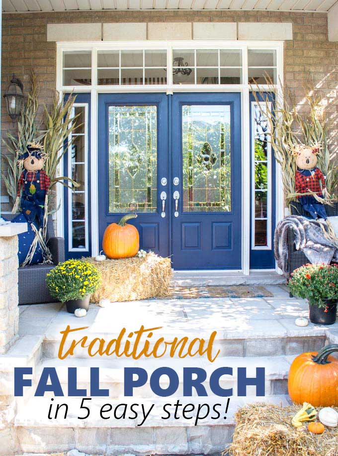 A front porch with blue doors decorated for fall with traditional hay, scarecrows and pumpkins