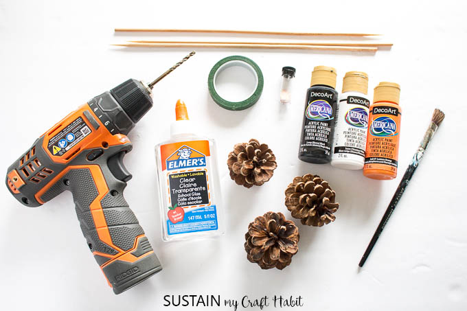 Supplies needed to make Halloween painted pine cone flowers