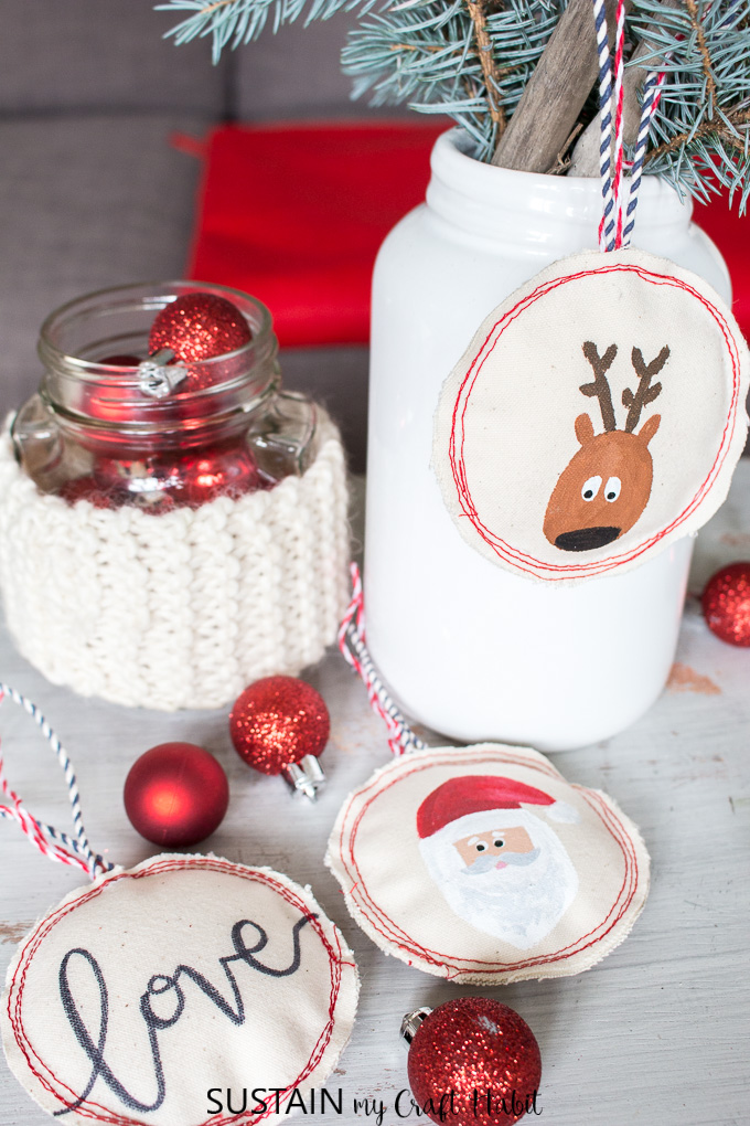 A festive display of red and white include sewn canvas Christmas ornaments with Santa, Reindeer and hand-lettered love sign