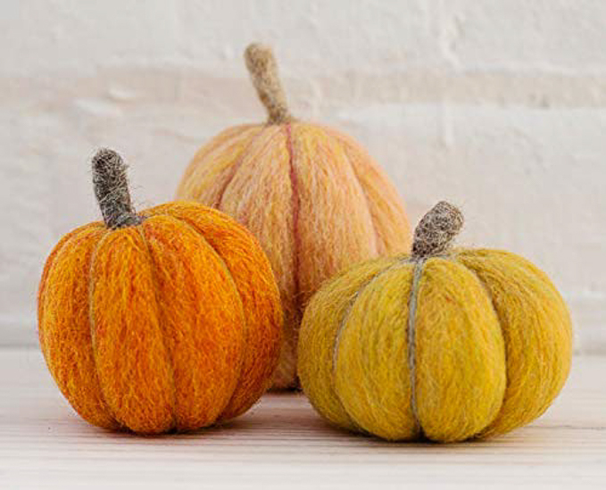 Pumpkins felted from wool roving in three shades of orange