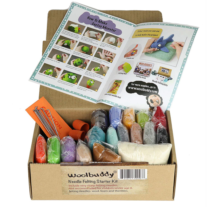 Supplies and book of instructions in a beginner needle felting starter kit by Woolbuddy