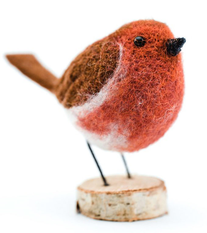 A beautiful wool felted bird made from a felting kit