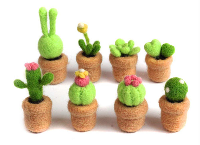 A collection of potted succulents to make from a DIY needle felting kit from Amazon