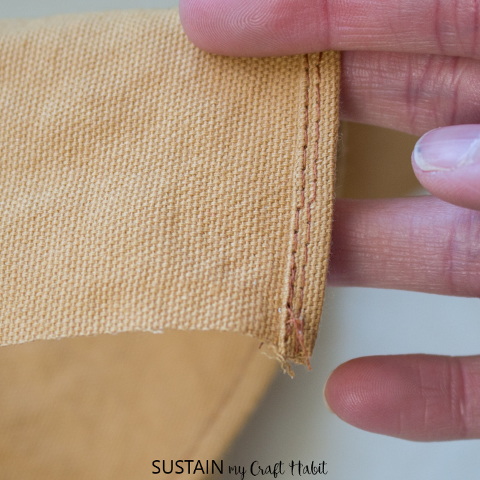 Showing a hem stitch on a DIY apron