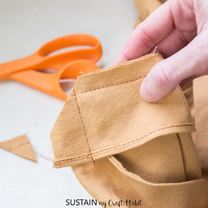 Showing a notch cut out of the corner piece of the DIY apron sewing pattern