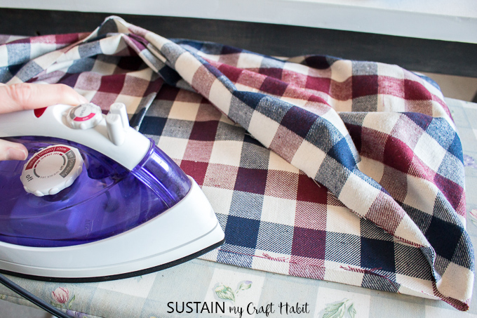 Ironing your new handmade infinity scarf as a finishing touch