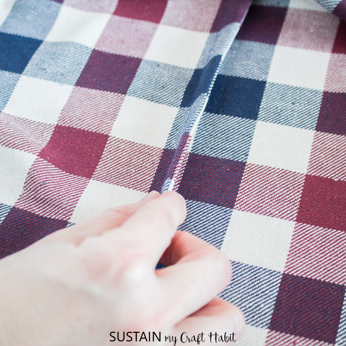 Demonstrating a french seam for this how to sew an infinity scarf tutorial