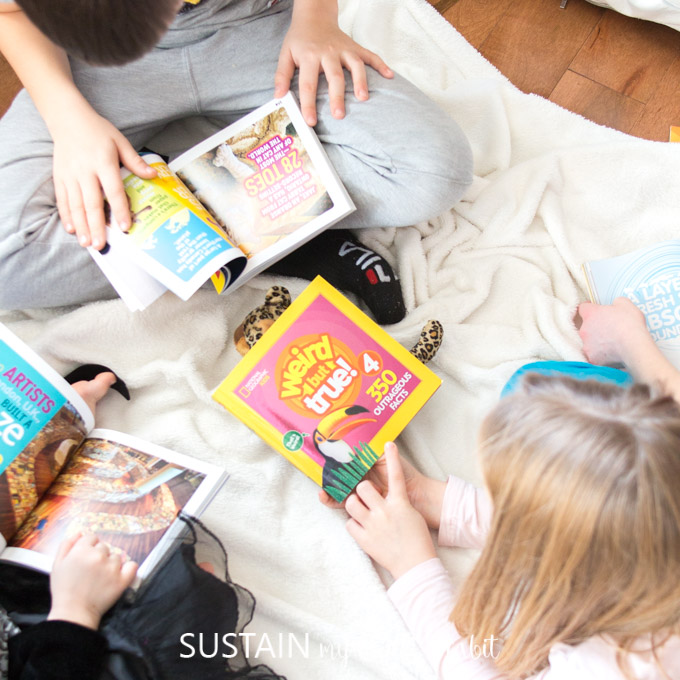An overhead image of kids reading Weird but True books