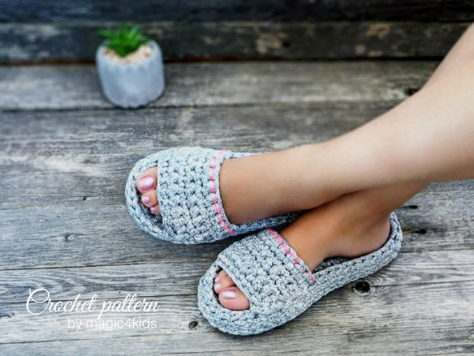 Woman wearing slippers made with gray tshirt yarn and a pink ribbon embellishment