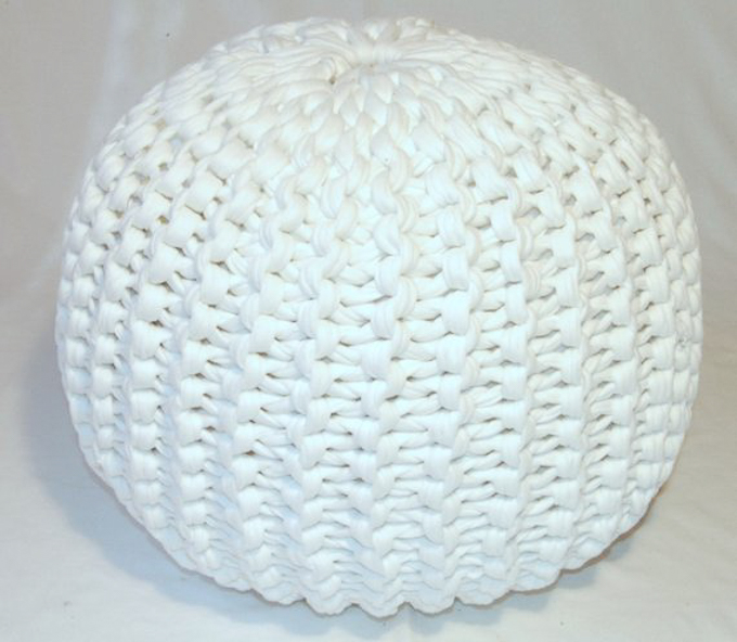 A round knitted pouf made with white tshirt yarn