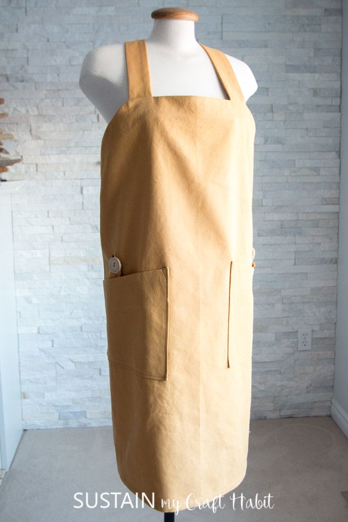 Front view of the DIY apron pattern with pockets and driftwood buttons