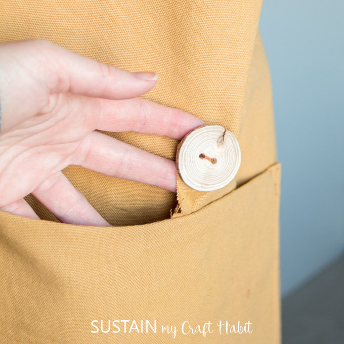 Handmade driftwood button on a DIY apron pattern