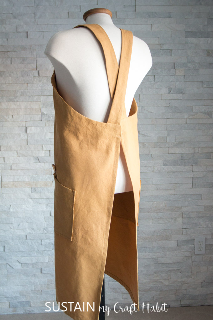 Back view of the criss-cross design of the DIY utility apron pattern