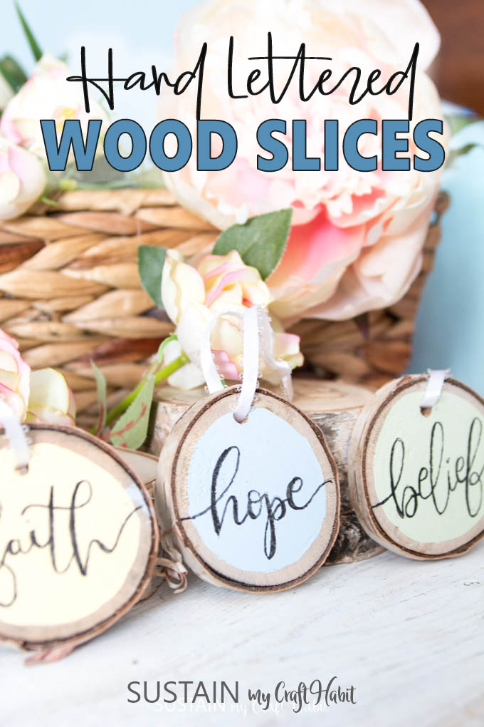 Hand lettered phrases on rustic birch wood slices