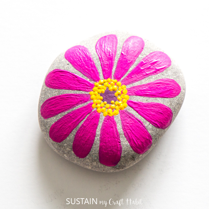Fully completed pink flower painted rock