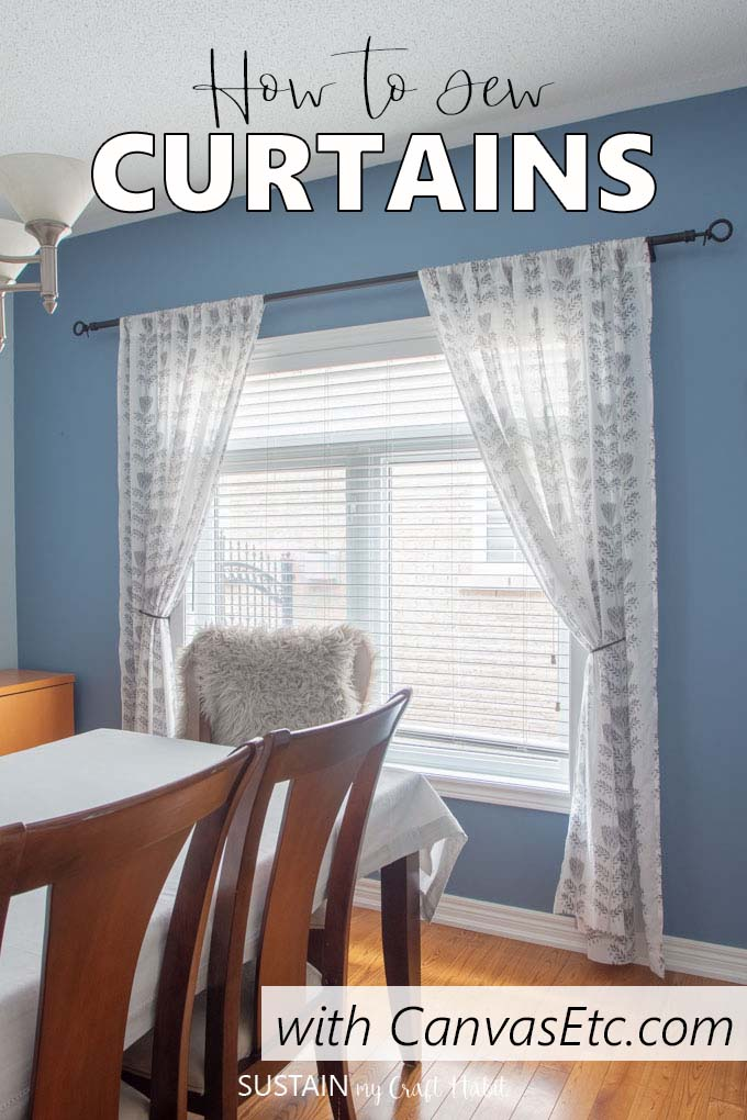 Handmade sheer curtains hanging in a dining room against a blue wall