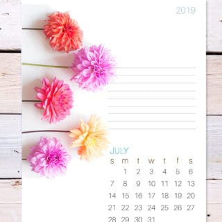 Image of July's printable calendar page including dahlia flowers on a rustic wood background.