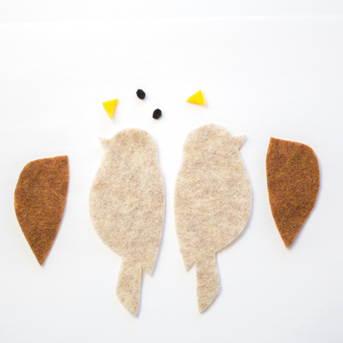 Cut out pieces of felt to make one brown felt bird bookmark.