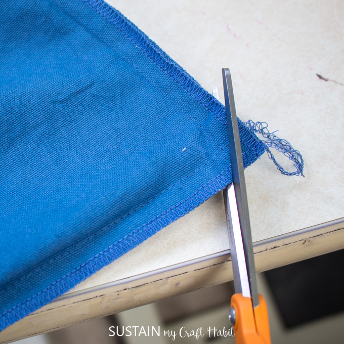 Cutting the corners off from the sewn bag to minimize bulkiness.