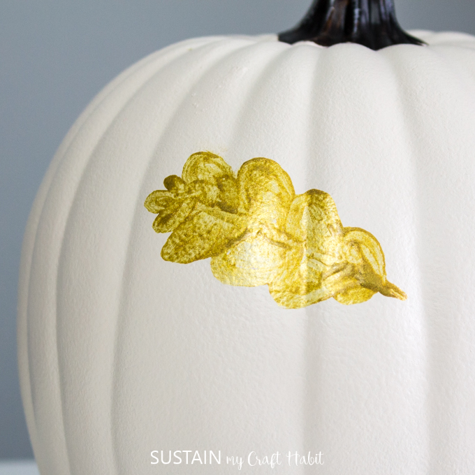 Close up on white pumpkin and full finished gold leaf.