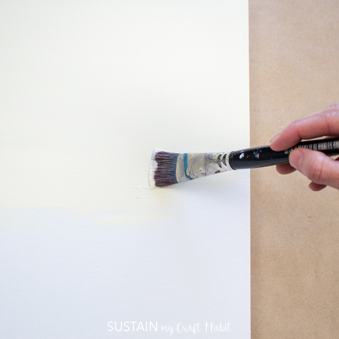 """woman painting a canvas with """"buttermilk color"""" paint"""