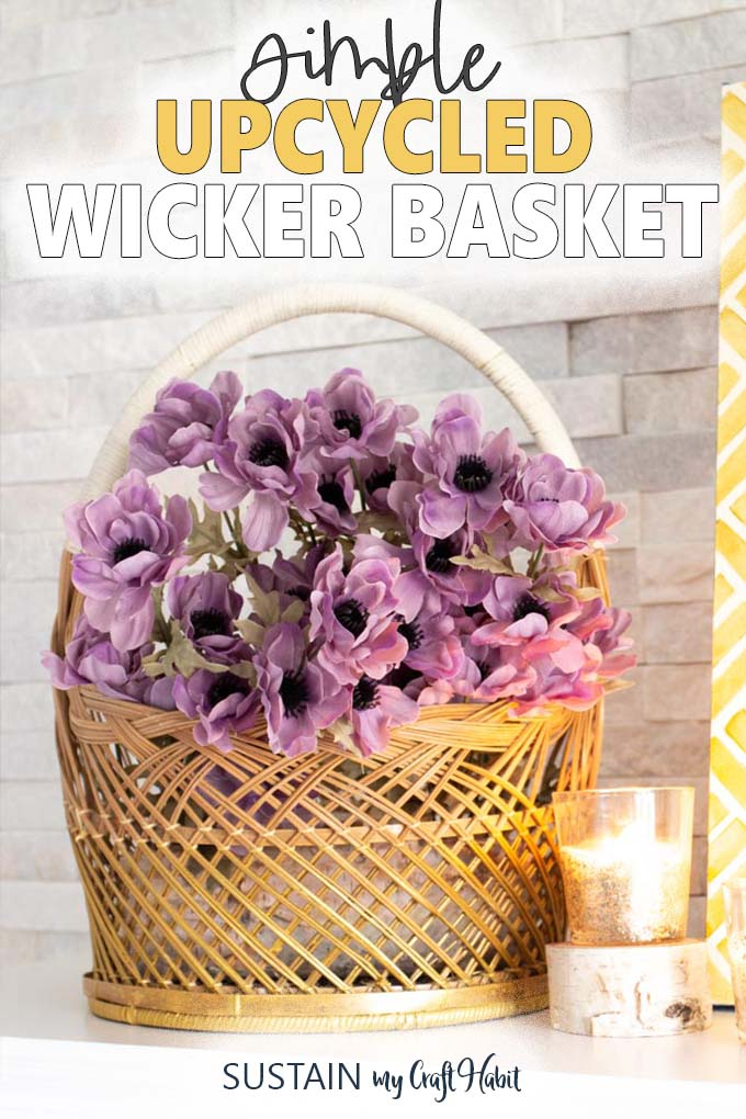 "The words ""simple upcycled wicker basket"" above a close up of a gold painted wicker basket with purple flowers and one lit candle."