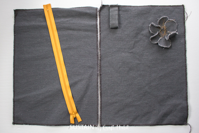 Image showing how to place the fabric pieces side-by-side to position the zipper prior to sewing.