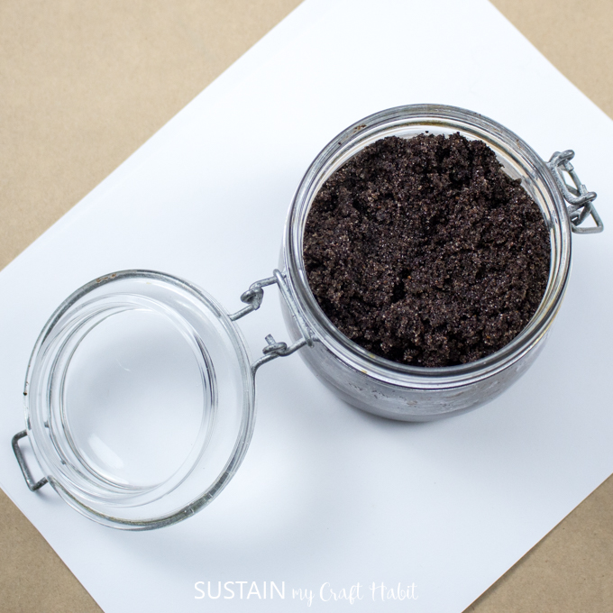 A sealable glass container filled with the finished DIY sugar scrub.