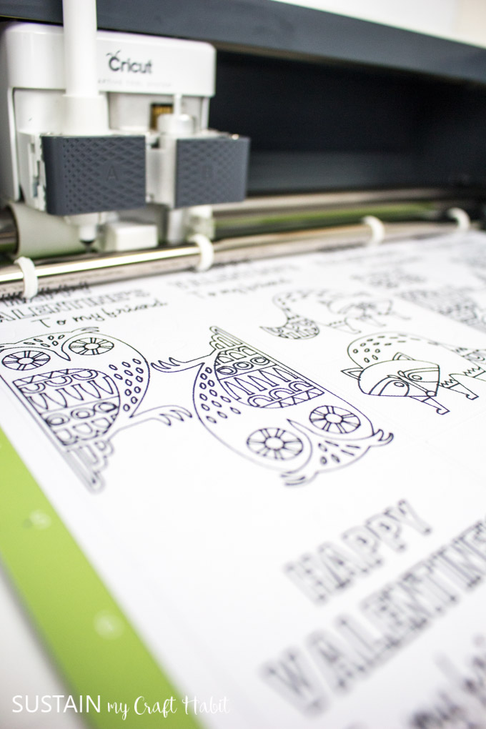 Close up image of the Cricut Maker machine cutting out the bookmarks.