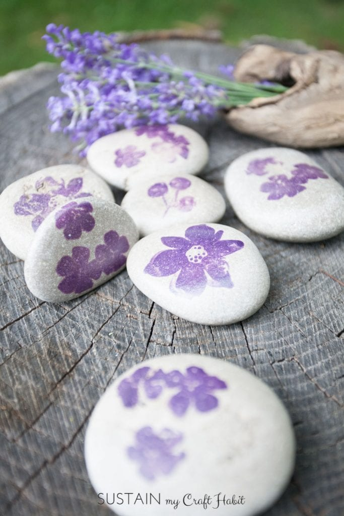 Small rocks stamped with purple flowers