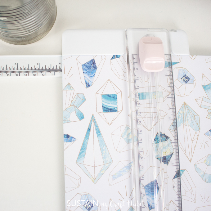 Cut Cricut's Deluxe Paper to size using a paper trimmer